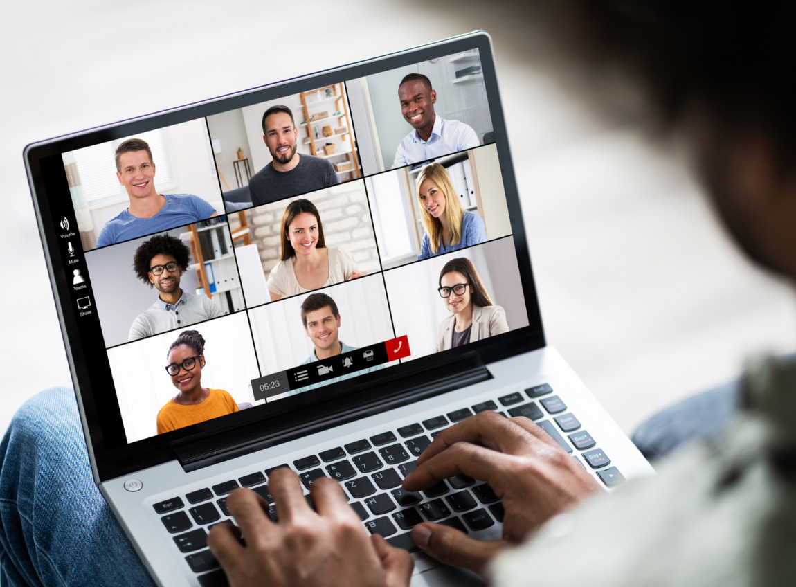 A Black man joins a video call from his laptop with peers.